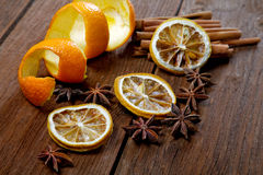 Dried peel of an orange and spice. On a table Stock Images