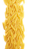 Dried penne pasta composition over white Stock Photos