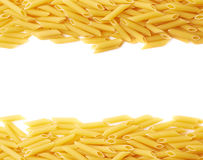 Dried penne pasta composition over white Royalty Free Stock Image