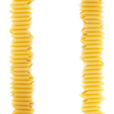 Dried penne pasta composition over white Royalty Free Stock Photos