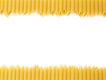 Dried penne pasta composition over white Royalty Free Stock Images