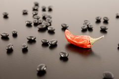 Dried Pepper amid Black Beans Royalty Free Stock Photo