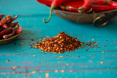 Dried pepper seeds and fresh chilli in background Stock Images