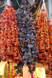 Dried peppers and eggplants on sale at bazaar Stock Images