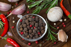 Dried peppers, garlic, chilli and rosemary on a board, top view Royalty Free Stock Photos