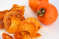 Dried persimmon slices Stock Photos
