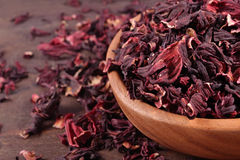 Dried petals of hibiscus in a wooden bowl Royalty Free Stock Photos
