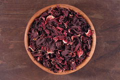 Dried petals of hibiscus in a wooden bowl Stock Photography