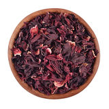 Dried petals of hibiscus in a wooden bowl on a white Stock Image