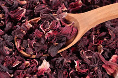 Dried petals of hibiscus in a wooden spoon Royalty Free Stock Images