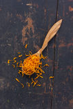 Dried petals Jerusalem artichoke in a wooden spoon Royalty Free Stock Photography