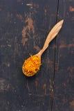 Dried petals Jerusalem artichoke in a wooden spoon Royalty Free Stock Image
