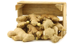Dried pieces of ginger root in a wooden crate Royalty Free Stock Images