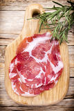 Dried pig meat slices. Delicatess. Stock Photos