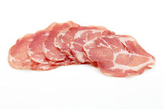 Dried pig meat slices. Delicatess. Royalty Free Stock Photography