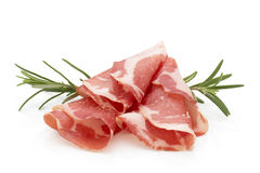 Dried pig meat slices. Delicatess. Royalty Free Stock Photo
