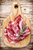 Dried pig meat slices. Delicatess. Stock Photography