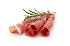 Dried pig meat slices. Delicatess. Royalty Free Stock Image