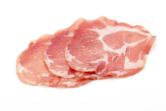 Dried pig meat slices. Delicatess. Dried pig meat slices.  Delicatess Royalty Free Stock Photo