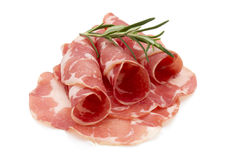 Dried pig meat slices.  on the white background. Delicatess. Stock Photos