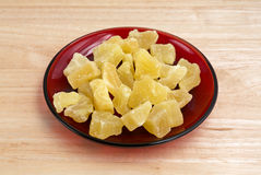 Dried pineapple chunks on red plate Royalty Free Stock Photography