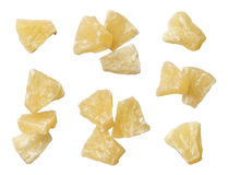Dried pineapple pieces isolated on white background Stock Photos