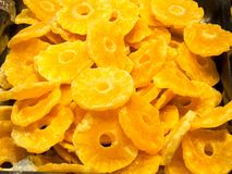 Dried pineapple slices. Stack of bright yellow dried pineapple slices with holes where the core has been removed. These rings are delicious and natural sweet Stock Photos