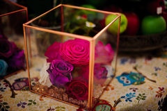Dried pink roses heads and petals in glass box Stock Photography