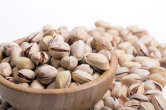 Dried pistachios. In a bambus bowl stock photo