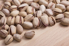 Dried pistachios. On wooden plate stock images