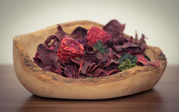 Dried plants in wooden bowl. A nice decoration every household should have Royalty Free Stock Photography