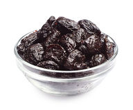 Dried plum in a glass bowl Royalty Free Stock Photography