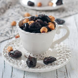 Dried plum and nuts Royalty Free Stock Image