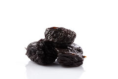 Dried plum - prunes isolated. Dried plum - prunes fruits isolated on a white background stock photography