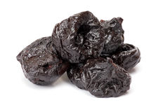 Dried plum - prunes, isolated on a white background. Stock Photos