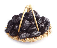 Dried plum in a wicker basket Royalty Free Stock Image