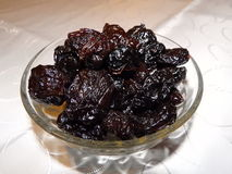 Dried plums in a bowl.  Royalty Free Stock Photo
