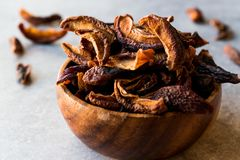 Dried Plums Fruits in wooden bowl. Organic Food Royalty Free Stock Photo