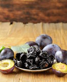Dried plums prunes and fresh berries Stock Photography