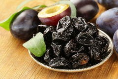 Dried plums prunes and fresh berries royalty free stock images