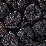 Dried plums or prunes fruit background texture pattern Royalty Free Stock Image