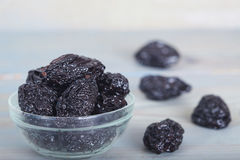 Dried plums or prunes. In glass bowl Royalty Free Stock Photos