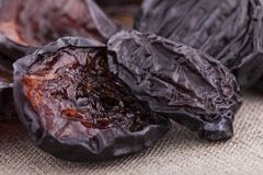 Dried plums on textile background Stock Images