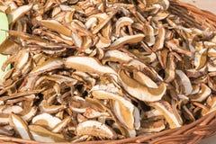 Dried porcini mushrooms in wicker bowl Stock Image