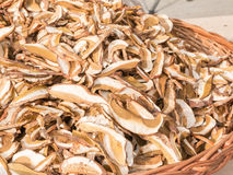 Dried porcini mushrooms in wicker bowl Stock Photos