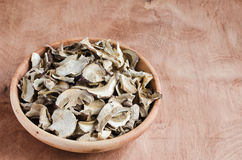 Dried porcini mushrooms on a wooden table. Rustic style. Royalty Free Stock Photography