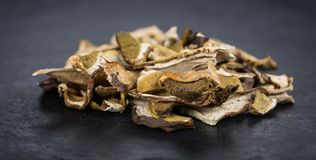 Dried Porcinis on a slate slab, selective focus Royalty Free Stock Photography