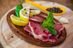 Dried pork with lemon, pepper and basil Stock Image