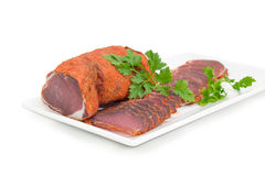 Free Dried Pork Tenderloin Partly Sliced With Parsley On White Dish Royalty Free Stock Photo - 84218815