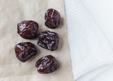 Dried prune on paper bag Royalty Free Stock Photography
